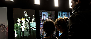"Right at the start, visitors undergo their own digital transformation in Bernd Lintermann's interactive installation, ""YOU:R:CODE"": starting with their mirror image, visitors are transformed bit by bit into a digital data body until they are ultimately represented entirely as code."