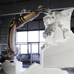 "In Davide Quayola's ""Sculpture Factory"" series, industrial robots create sculptures inspired by Michelangelo in real time in the art gallery. So generating art becomes part of the installation itself."