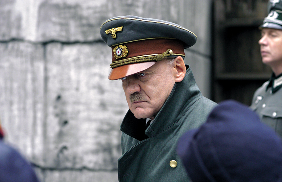 "<b>""Downfall""</b> <br>It is possible to portray Hitler with even a modicum of humanity? Released in 2004, <i>Der Untergang</i> was the very first film since the end of World War II to focus primarily on the figure of Adolf Hitler and depict the final days in the Führer's bunker. While the film was a national and international box-office success, it kicked off vehement discussion in Germany, especially among historians, about how Hitler could be portrayed in film. While some were convinced that showing Hitler as a person with feelings helped demystify him as a historical figure, others vehemently opposed allowing any form of emotional association. Both producer Bernd Eichinger and lead actor Bruno Ganz received the Bavarian Film Award, and <i>Der Untergang</i> was also nominated for an Oscar as best foreign language film."