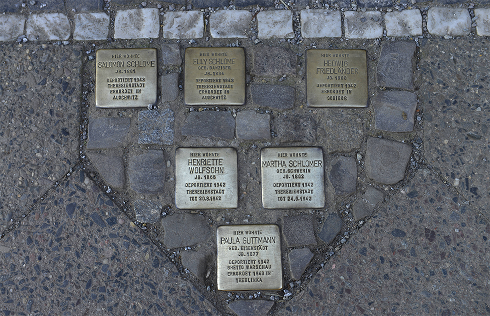 "<b>Stolpersteine (stumbling stones)</b> <br>A small commemorative plaque in front of every house in which the persecuted or deported once lived: since 1992, artist Gunter Demnig has been installing his <i>stolpersteine</i>, pavers topped by a brass plate that commemorate the victims of National Socialism. Each stone is inscribed with ""Hier lebte"" (here lived), followed by the name, and date and place of death of a person murdered by the Nazis. The stones are set in the pavement in front of their last place of residence. What began as a small art project has now spread to 21 European countries, making <i>stolpersteine</i> Europe's largest decentralized memorial."