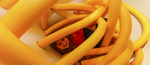 "A child playing in the Minischirn ""puzzle room"" in Frankfurt's Schirn Kunsthalle. Children three and older can play and learn on the interactive adventure course while their parents take in an exhibition."