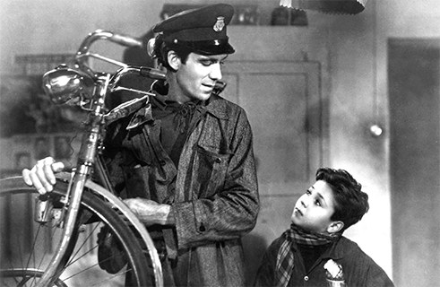 "<b>""Bicycle Thieves"" by Vittorio de Sica (1948)</b><br>The Italian neorealist film movement emerged in the mid-1940s in response to fascist dictator Benito Mussolini's rule of Italy. Inspired by Marxism and poetic realism, writers and directors strived to portray real, everyday life in war-torn Europe as authentically as possible. <i>Bicycle Thieves</i> by Vittorio de Sica is considered a masterpiece of the genre. It follows the fate of a father working as a day labourer to feed himself and his family. Just when he has finally found a steady job putting up posters, his bicycle is stolen. The protagonist is driven to steal a replacement, which results in serious repercussions. De Sicas' film is a repudiation of a merciless capitalist class society that pits the poorest against each other and a plea for solidarity."