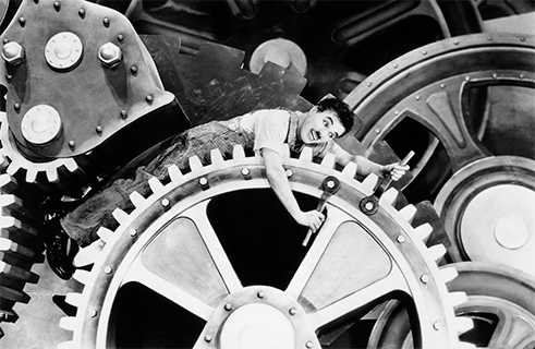 "<b>""Modern Times"" by Charlie Chaplin (1936)</b><br>Charlie Chaplin's childhood was marked by bitter poverty. In his slapstick comedies, the US director and actor always took up the causes of the poor and disenfranchised, pointing out the social injustices caused by capitalist modes of production. <i>Modern Times</i> from 1936 portrays the hardscrabble life of Chaplin's famous tramp figure following the Great Depression of 1929, years shaped by mass unemployment and Fordist capitalism. There has never been a more playful and entertaining depiction of Marx's concept of ""estranged labour"" than the famous factory scene in which the tramp falls onto a conveyor belt and is pulled into the cogs of a giant machine."