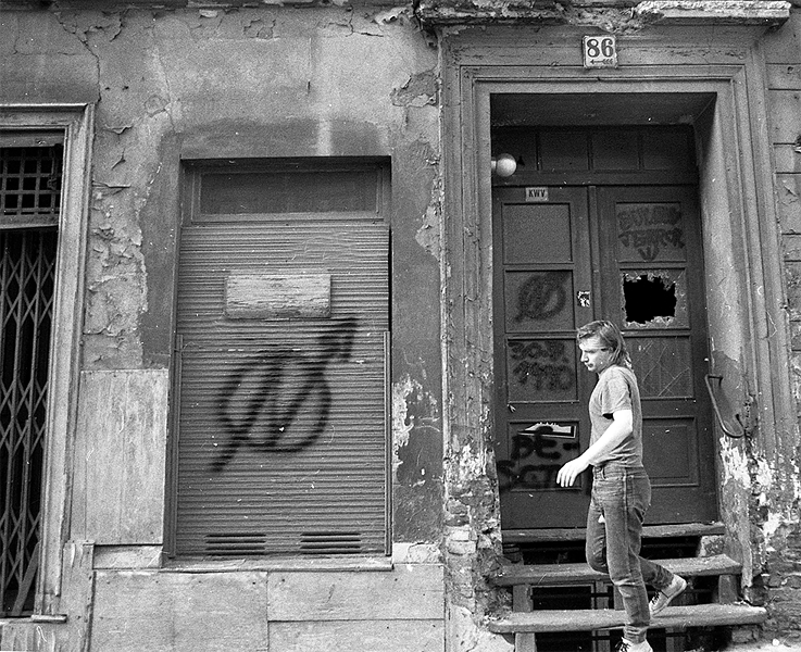 The symbol of the squatter scene was a circle with an N-shaped flash of lightning - seen here on a dilapidated house in Oranienburgerstrasse in East Berlin, taken in the summer of 1990.
