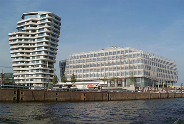 <b>Marco Polo Tower in Hamburg</b><br/>Modern and futuristic: Completed in 2009, the Marco Polo Tower designed by Stuttgart-based Behnisch Architekten is an elegant shape in Hamburg's silhouette as seen from the Elbe River. Each of the 17 stories is slightly offset and larger than the floor below, so the curved, terraced apartment building resembles a huge funnel.