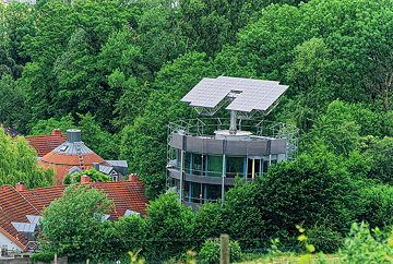 "<b>Heliotrope in Freiburg, Breisgau</b><br/>Designed by architect Rolf Disch, the flats in this ""revolving solar house"" in Freiburg am Breisgau were ready for occupants in 1994. The apartment building has windows on one side and rotates to track the sun, taking full advantage of weather conditions. Combined with sophisticated thermal insulation and a flexible solar power system, the building produces around five times as much energy as it consumes. Disch also designed the Freiburg Solar Settlement of 59 plus-energy houses."