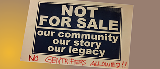 "A cardboard protest sign stating ""NOT FOR SALE Our Community Our Story Our Legacy"" with an added handwritten line ""No Gentrifiers allowed"""