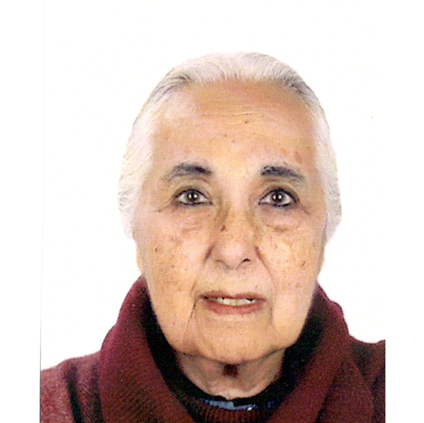 Head shot of Romila Thapar in front of a white backgrond, she has white hair and wears a wine-red turtleneck
