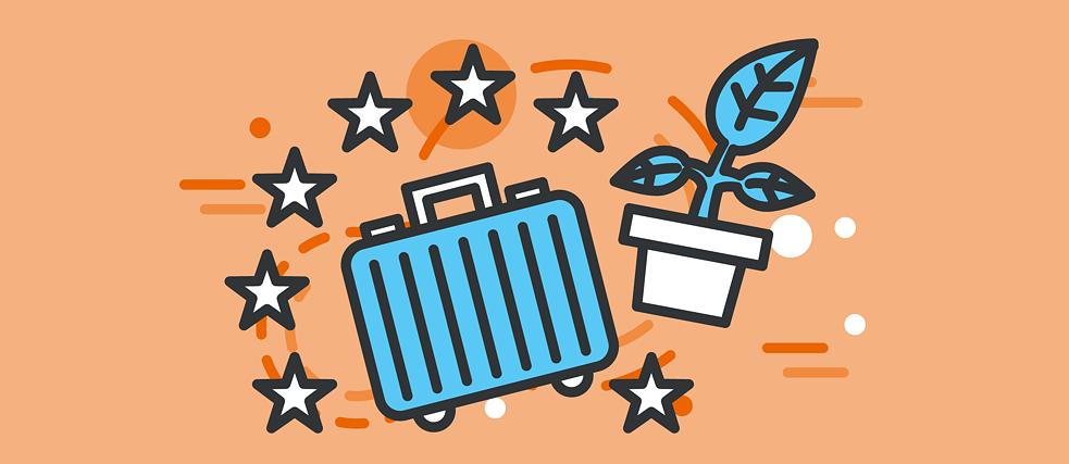 Wegweiser mit Globus und zwei EU-Koffer