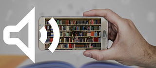 A white loudspeaker symbol and a hand with a smartphone on which a bookshelf is shown.